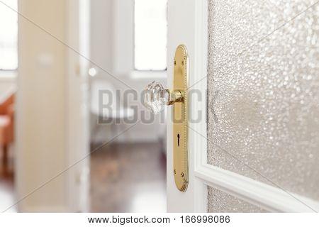 White Door With Glass and Gold Door Handle