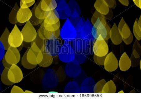 water drops background blue and gold bokeh effect dark black background