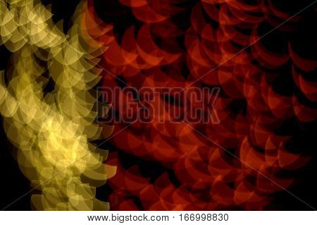 crescent moon bokeh effect red gold multicolored abstract dark black background