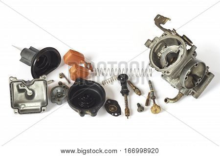 Old carburetor of motorcycle part disassembly isolate on white background.