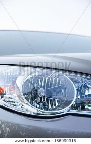 Luxury Car headlight close up. Luxury Car headlight close up