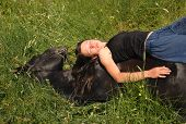 young teen and her best friend black stallion sleeping in grass poster