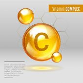 Vitamin C gold shining pill capsule icon . Vitamin complex with Chemical formula Ascorbic acid. Shining golden substance drop. Meds for heath ads. Treatment cold flu . Vector illustration poster