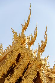 Gable of Toilet with Gold Color in Wat Rong Khun or White Temple Unique Styled Thai Temple in Chiang Rai.