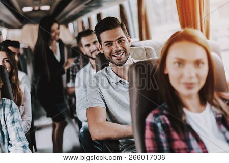 Young Smiling Man Traveling On Tourist Bus. Happy Beautiful Man Relaxing On Passenger Seat Of Tour B