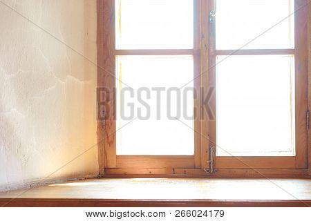 Wooden Window. Wide Wooden Window Sill. The Light In The Window
