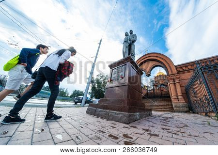 NOVOSIBIRSK, RUSSIA - 11 AUGUST 2018: Tourists near the monument to Tsar Nicholas II (Nikolai II) and Tsarevich Alexey on the territory of the St. Alexander Nevsky Cathedral in Novosibirsk.