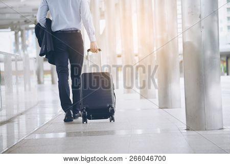Businessman Dragging Suitcase Luggage,walking To Passenger Boarding In Airport.asian Tourist Men Wea