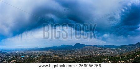 Wide Panorama Of Storm Clouds Over Spain Mountains