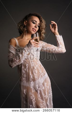 Photo Of Beautiful Sexy Girl Wears Luxurious Dress,holding Glass Of Champagne In Hand Isolated On Ba
