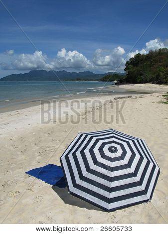 Sun umbrella on a sandy beach of Langkawi island Malyasia