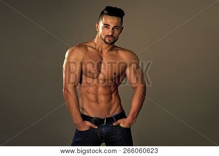 Coach Sportsman With Bare Chest In Jeans. Man With Muscular Body And Torso. Athletic Bodybuilder Man
