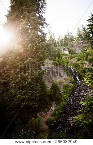 Artistic Sunburst View Of Vidae Falls Located Along The Rim Drive In Crater Lake National Park In Or