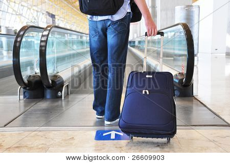 poster of Traveler with a bag at the speedwalk