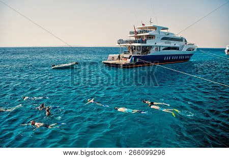 Hurghada, Egypt - February 24, 2017: Group Of People, Adults And Children, With Diving Masks And Sno