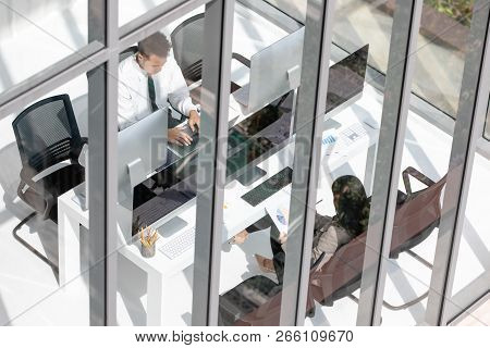 Young Office Partner Workers Are Dedicated To Working Hard In Modern Office. Businessman Looking Ser