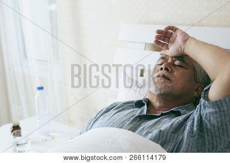 Elderly Patients In Bed, Asian Senior Man Patients Headache Hands On Forehead - Medical And Healthca