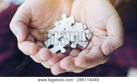 Close Up Hand People Putting A Jigsaw Puzzle On Hand , Business  Strategy Solution Concept