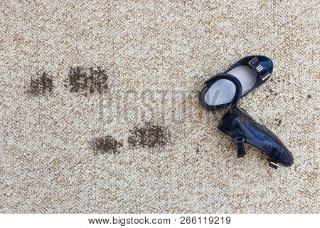 Dirty Floor And Children's Shoes. Concept Of Child Soiled Carpet.