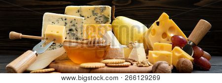 Various Types Of Cheese On A Rustic Table