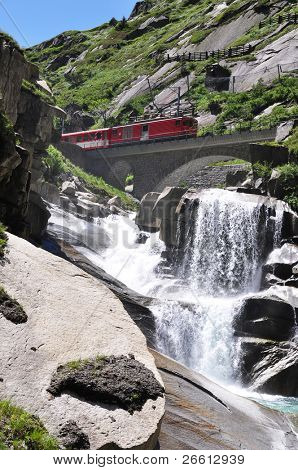 Alpine express passing bridge at St. Gotthard Pass in Switzerland poster