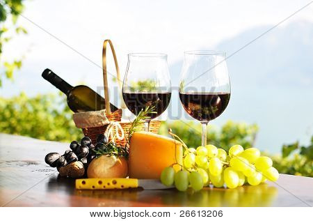 Red wine, grapes and cheese. Lavaux region, Switzerland
