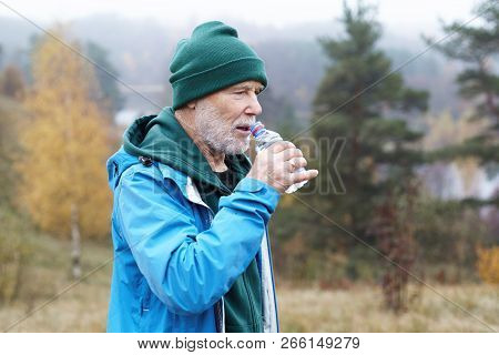 People, Lifestyle, Sports, Age, Health And Activity Concept. Outdoor Shot Of Athletic Bearded Mature