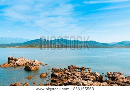 a view of the rock formations in La Tonnara, on the Southern coast of Corsica,  France, with the calm Mediterranean sea in the background