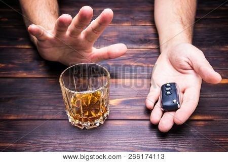 Drunk Driving. Glass In Man Hands And Car  Keys. Drink.