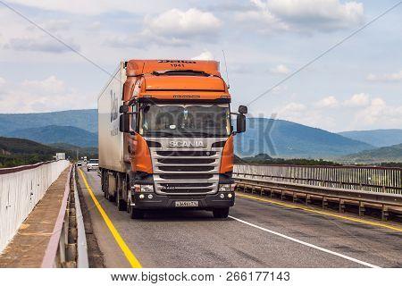 Bikin, Russia - June 6, 2018: Orange Scania Truck On A Road. Delko Company