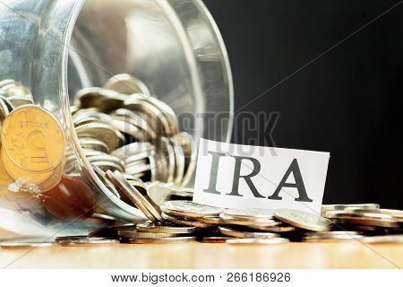 glass jar used for saving US dollar bills and notes for IRA retirement fund poster