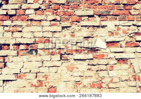 Stone texture background of red brick wall, texture of stone red bricks. Architecture background with weathered stone wall