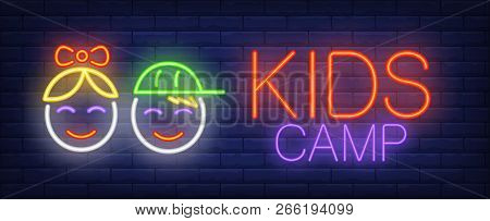 Kids Camp Neon Sign. Glowing Neon Inscription With Baby Faces Of Girl And Boy On Blue Brick Backgrou