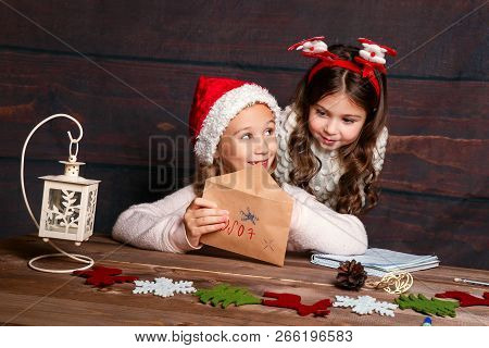 Child Writes Letter To Santa Claus . Funny Girls In Santa Hat Writes Letter To Santa