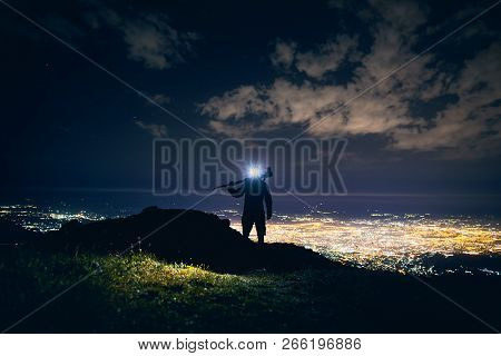 Photographer In The Mountains At Night