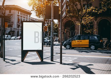 Outdoor Empty Informational Board Placeholder With A Road And Taxi Car Behind; White Blank City Bill