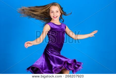 Ballroom Fashion. Girl Child Wear Velvet Violet Dress. Kid Fashionable Dress Looks Adorable. Ballroo
