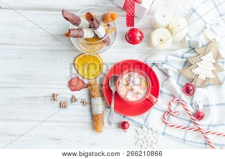 Cup Of Cocoa With Marshmallows Wits Fruits Pastille And Chips, Holiday Decor On Breakfast Of Christm