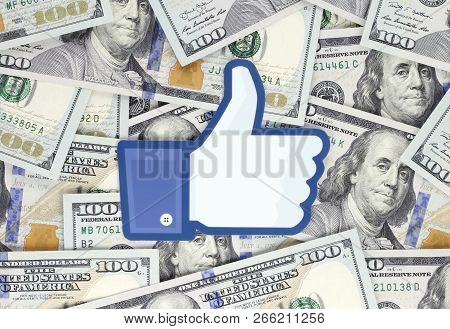 Kiev, Ukraine - September 18, 2018: Facebook Like Logo Printed On Paper, Cut And Placed On Money Bac