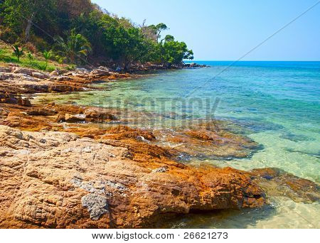 Rocks on the seashore and clear water