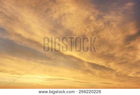 Sunset Sky Background With Soft Yellow Sky Color. Scenic Sky Cloudscape At Sunset Or Sunrise, Dusk A