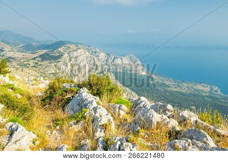 Hills And Rocks Of Biokovo Mountain Range In Front Of Makarska Riviera Adriatic Sea, Dalmatia, Croat