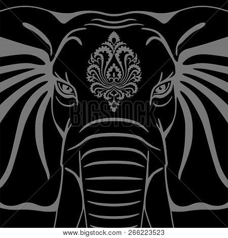 Elephant Head With A Decorative Element On A Black Background