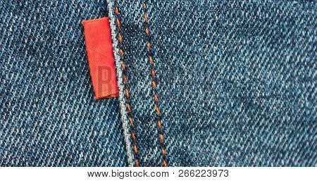 Denim Blue Jeans With Empty Red Label Close Up Top View. Casual Vintage Style Jean Clothing Back Sid