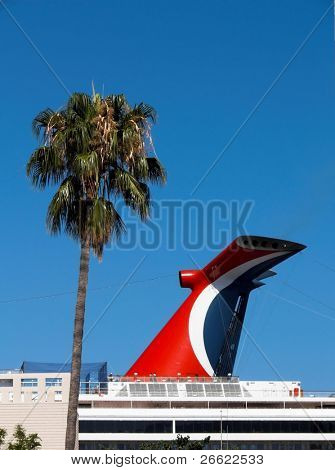 Chimney of cruise ship in tour and palm