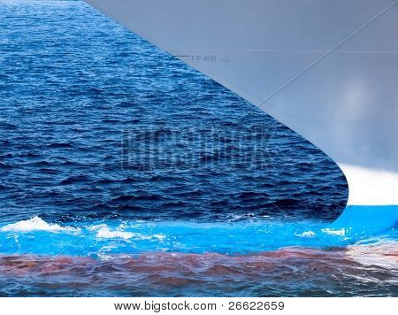 Style, shape and colors of  prow and of the water line of hull of a cruise ship in tour on the sea