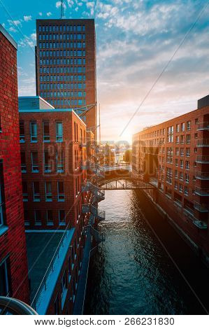 Hafencity. Bridge Over Canal And Red Brick Buildings In The Old Warehouse District Speicherstadt In