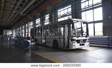 Bus Production Manufacture. Scene. Inside Bus Factory. Almost Ready-made Buses At Factory Concept Of