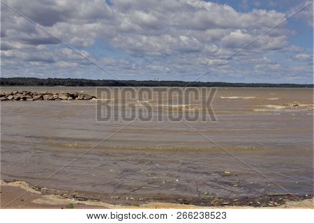 Blue Sky And Clouds, Rocks, Shore Land On The Bay