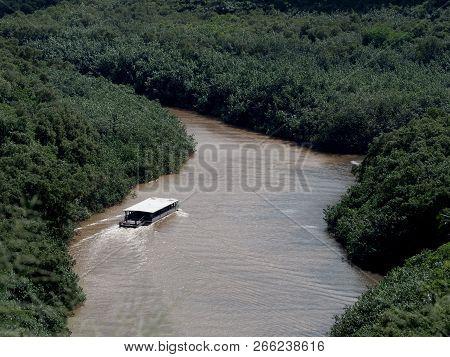 Kauai, Hawaii - November 13, 2017: Aerial Of River Boat Travels Wailua River.